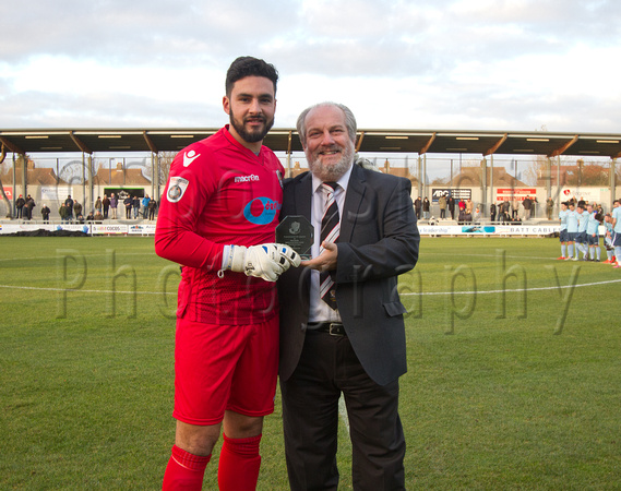 Deren Ibrahim presented with an award for 100 appearances for Dartford by co-Chairman Steve Irving